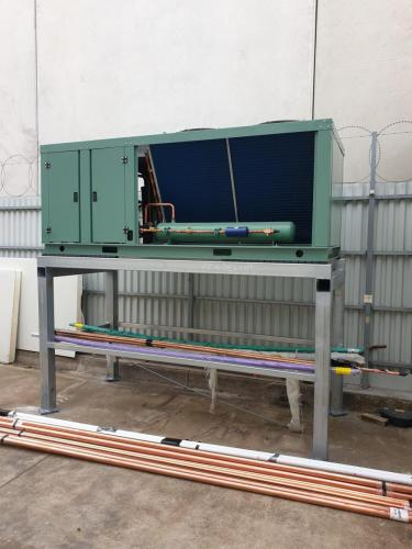Outdoor_unit_mounted_on_frame_work_1